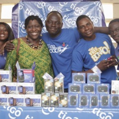Tigo staff with Ms. Thomson